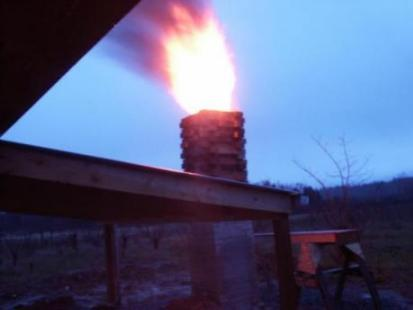 dusk, fire from the chimney