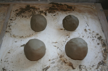 four lumps of prepared test clay